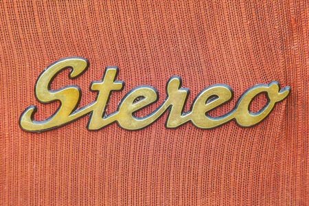 oldie: Close up of a vintage jukebox with the text stereo in gold color