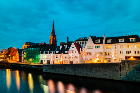 Evening view of the Dutch Maastricht city center with the river Maas in front