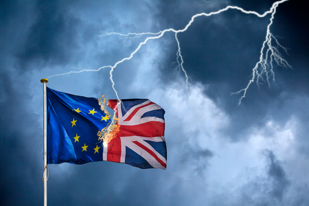 Concept of the British Brexit with the English flag struck by lightning in a heavy storm