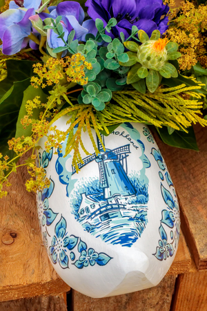 Dutch souvenir clog with painted windmill filled with flowers