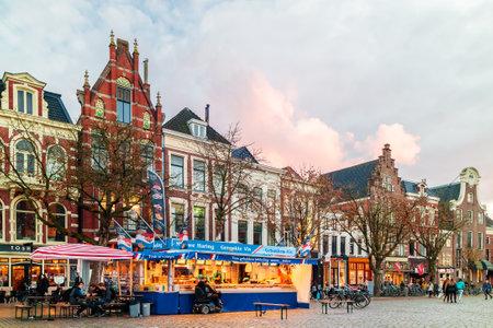 GRONINGEN, THE NETHERLANDS - NOVEMBER 2, 2017: Fish market stall on the Dutch Vismarkt square during sunset in Groningen, The Netherlands