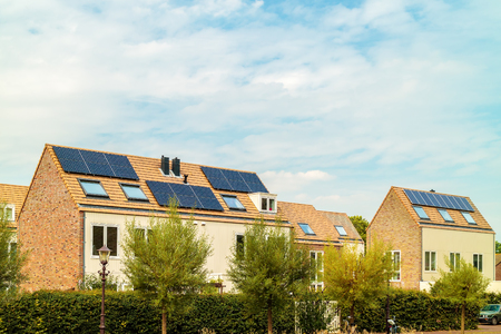 Row of new Dutch houses with solar panels in Amsterdam