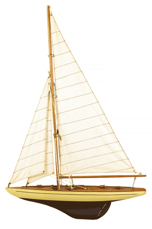 Vintage wooden model sailing yacht isolated on a white background