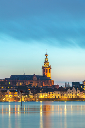 The Dutch city of Nijmegen with the flooded river Waal in front during the evening