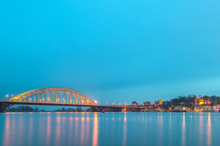 Evening view of the Dutch city of Nijmegen with the flooded river Waal in front