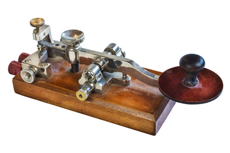 Ancient morse code telegraphy device isolated on a white background