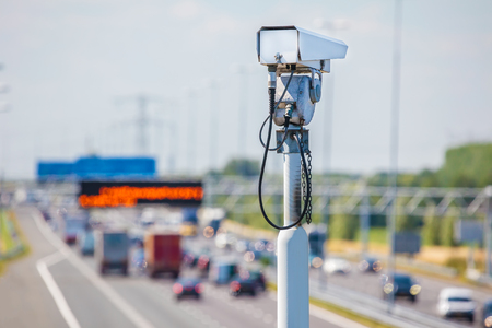 Surveillance camera in front of a Dutch highway with traffic Reklamní fotografie