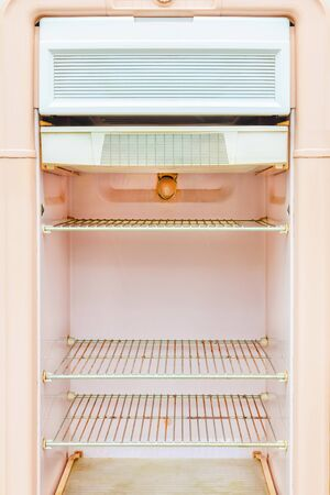 Interior of a retro pink fridge from the fifties
