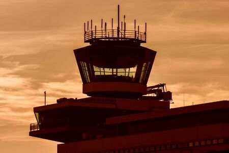 Air traffic control tower during sunset on Schiphol airport in The Netherlands