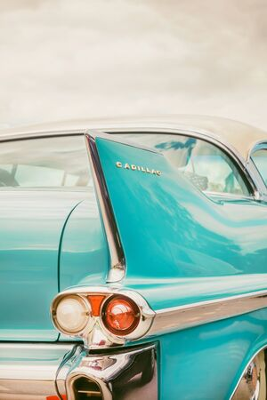 DEN BOSCH, THE NETHERLANDS - MAY 12, 2019: Retro styled rear end of a classic blue Cadillac fifties car in Den Bosch, The Netherlands