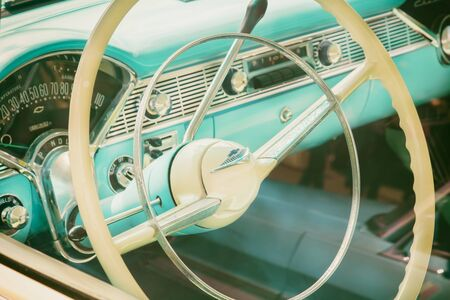 DEN BOSCH, THE NETHERLANDS - MAY 12, 2019: Retro styled image of the interior of a classic blue Cadillac fifties car in Den Bosch, The Netherlands
