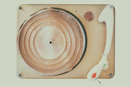 Retro styled image of an ancient sixties weathered turntable