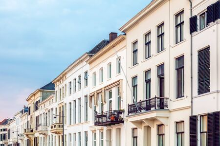 Row of ancient white houses in the Dutch city center of Zutphen, The Netherlands Фото со стока