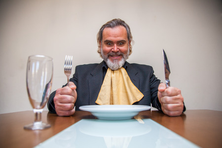 Man sitting at the table ready to eat