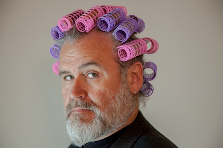 Man with head full of hair rollers Zdjęcie Seryjne