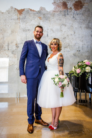 Newlywed couple pose right after their marriage ceremony