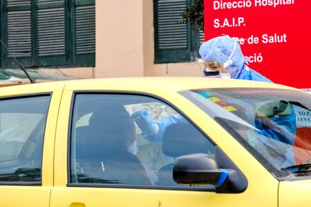 Valencia, Spain; 30th Mar 2020: Healthcare personnel perform a rapid coronavirus test on a patient without him getting out of his car outside Malvarrosa Hospital. These tests are carried out at various points in the city when hospitals have the appropriat