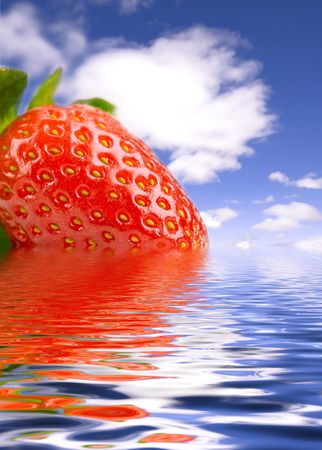 Strawberrie on scene of water and sky Stock Photo