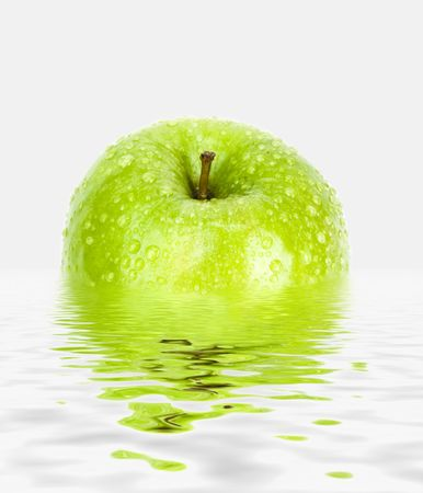 green apple with drops on water background