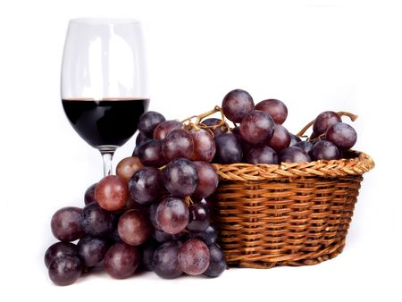 Wine and red grapes in a traditional basket, isolated. photo