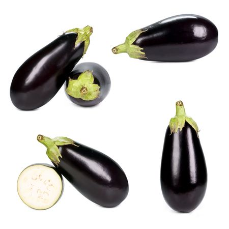 Eggplants isolated on white, different viewpoints.