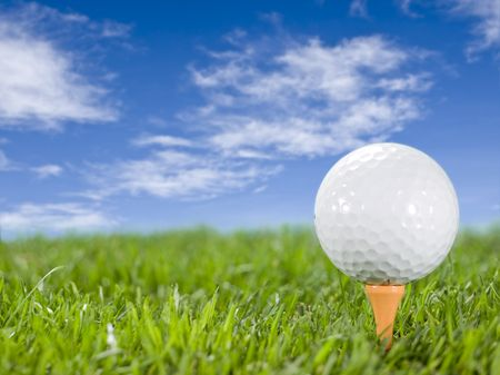 Golfball in the grass on the tee Stock Photo