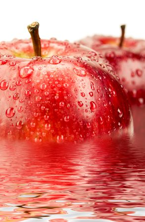 red apple with drops on water background Stock Photo