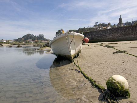 Aground boat, in the small interior beaches, that are formed during the low tide. (Asturias-Spain)