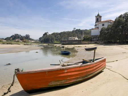 Aground boats, in the small interior beaches, that are formed during the low tide. (Asturias_Spain)