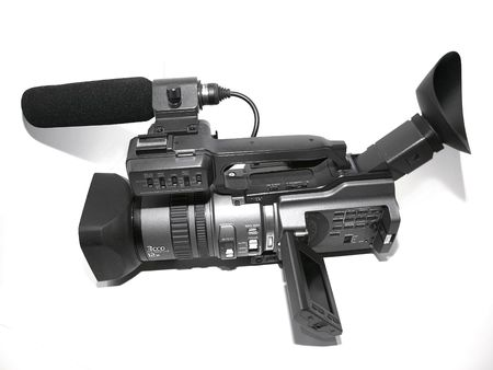 Professional camcorder with microphone and visor Stock Photo