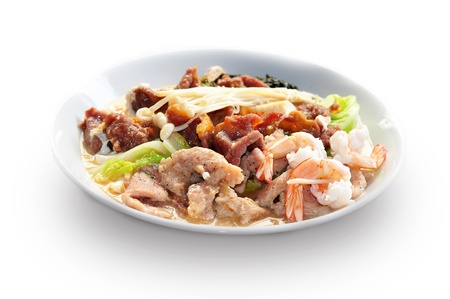 Sukiyaki with pork, beef and shrimp, Asian cuisine, isolated on white photo