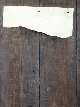 recycled paper ripped on real wood background photo