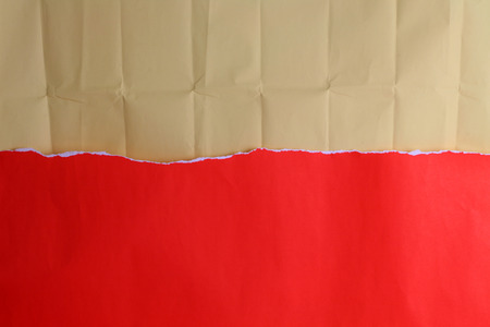 crinkled: Ripped red paper with crinkled brown paper  for background