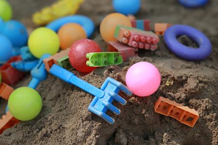 sandpit: Colorful plastic children toys in sandpit