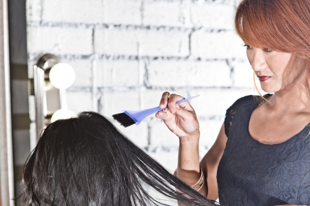 hair stylist: Hair stylist attempting to color hair Stock Photo