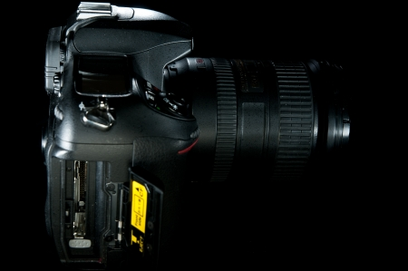 sd: Open compact flash bay for a black DSLR profile shot