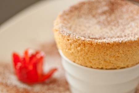 Yummy Souffle with Strawberries and power on a white plate close up Stock Photo