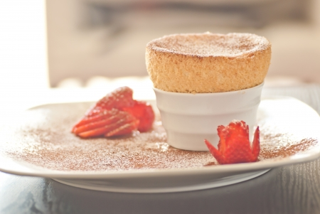 souffle: Yummy Souffle with Strawberries and power on a white plate