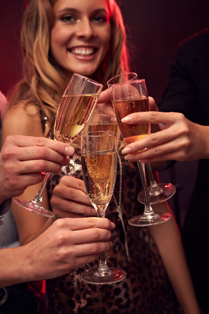 flutes: People clinking from champagne flutes at party