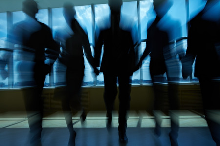 manager team: Silhouettes of people in office going ahead