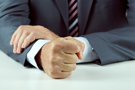 rudeness: Close-up of a male fist. Tyranny in office Stock Photo