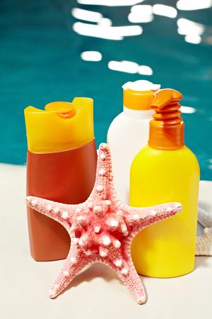 moisturizers: Set of sunscreen moisturizers and a starfish Stock Photo