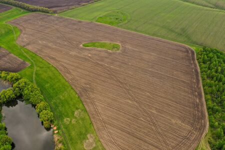 Aerial view of a field prepared for landing. Agricultural Field in rural areas Reklamní fotografie