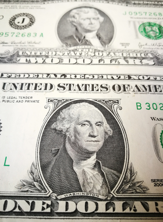 us money: Close up of US dollar bank note with image of Jefferson and Washington. US money background.