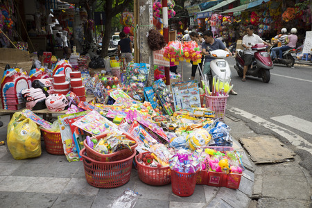 Hanoi, Vietnam - Sep 2, 2015: People stop to buy teddy and colorful toys on Hang Ma old street in time of lunar August full moon festival.