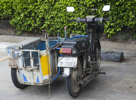 three wheeler: Pattaya, Thailand - Jul 17, 2015: Close up of a D.I.Y tri wheel motorcycle used to transport good and product on a side walk of a street in Pattaya.