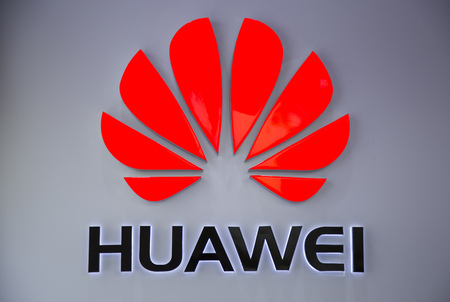 Shenzhen, China - Jun 13, 2016: Close up of the logo of Huawei Technologies Company at an authorised mobile phone shop in Shenzhen city. The Chinese multinational company headquartered in Guangdong. Editorial