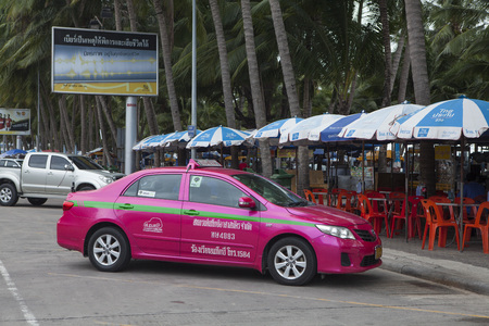 departmentstore: Pattaya, Thailand - Jul 18, 2015: A colorful taxi parking on the car park area on the street of Pattaya beach and waiting for passenger. Pattaya is a town on Thailands eastern Gulf coast.