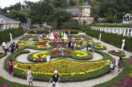 Da Nang, Vietnam - Jun 20, 2016: Tourist visiting a floral garden with many kind of colorful flower in Ba Na Hills mountain resort, Da Nang, Vietnam.