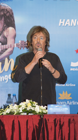 ballad: Hanoi, Vietnam - Sep 30, 2016: Chris Norman (Smokie ex-singer) joining a press briefing before the show mix with disco and rock ballad. No release require for editorial.
